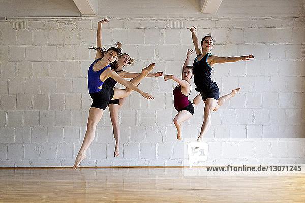 Full length of ballet dancers in studio