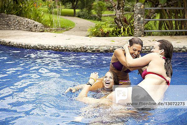 Women enjoying in swimming pool
