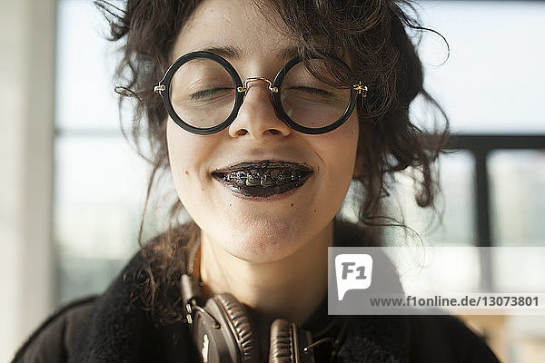 Close-up of woman with messy mouth eating ice cream at home