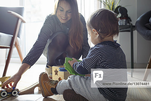 Mother and son playing with toys at home