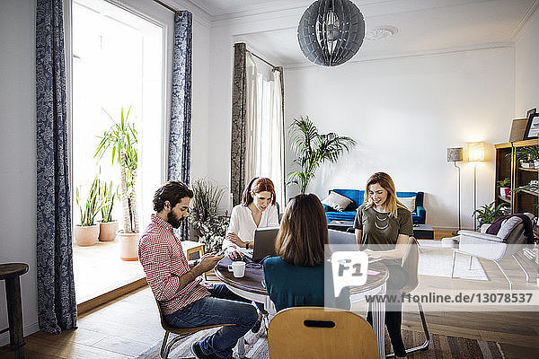 Creative people working at table in creative office