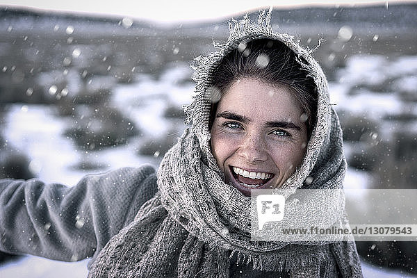 Close-up portrait of cheerful woman during winter