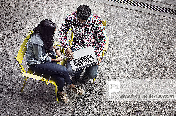 Elevated view of couple using laptop