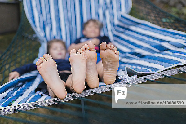 High angle view of brothers resting in hammock