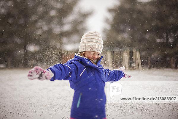 Happy girl enjoying snow