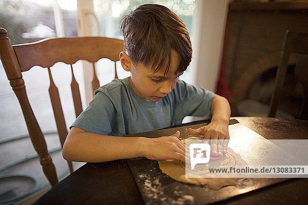Boy preparing cookies at home