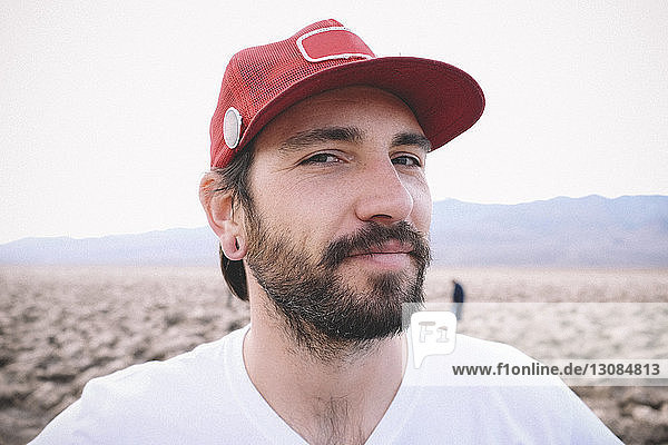 Portrait of confident man wearing cap at Death Valley National Park