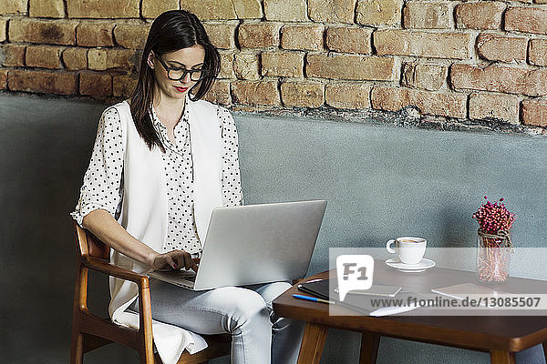 Beautiful businesswoman using laptop at hotel lobby