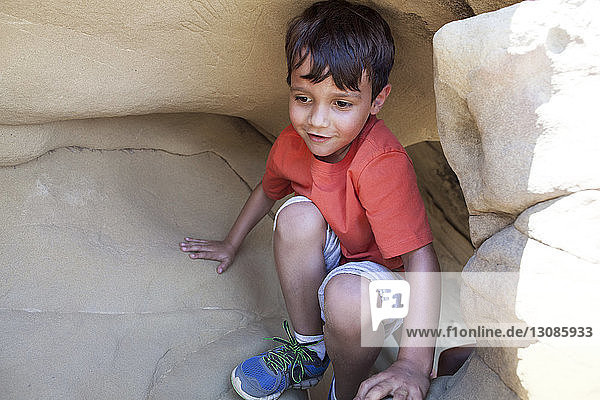 Happy boy playing in cave