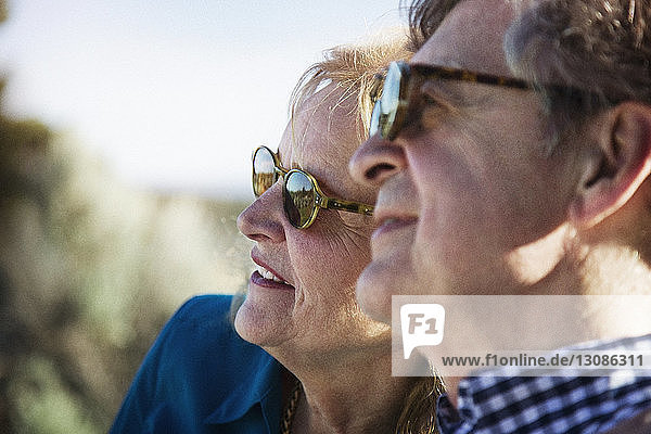 Close-up of senior couple looking away