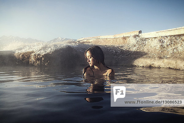 Woman relaxing in Mammoth Lake Hot Springs