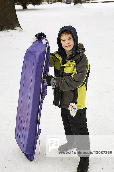 Boy with sledge