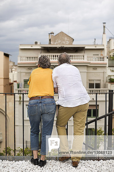 Rear view of senior couple standing on terrace