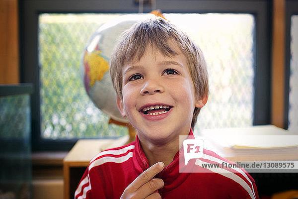 Portrait of boy in classroom