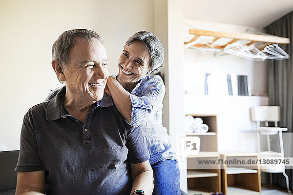 Cheerful senior couple spending quality time in bedroom