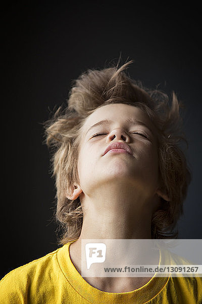 Portrait of boy with eyes closed