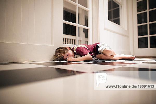 Boy sleeping on floor