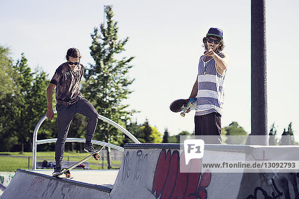 Young skateboarders on ramp