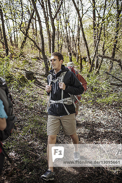 Male hikers walking in forest