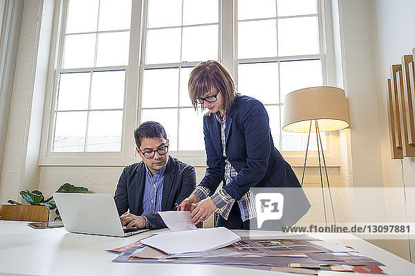 Business people discussing at desk in office