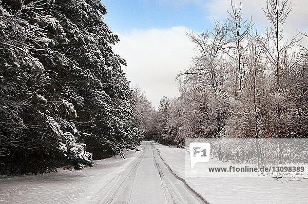 Empty road in snow winter