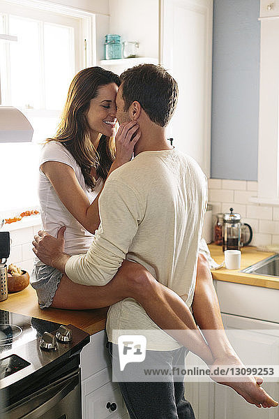 Affectionate couple in kitchen at home