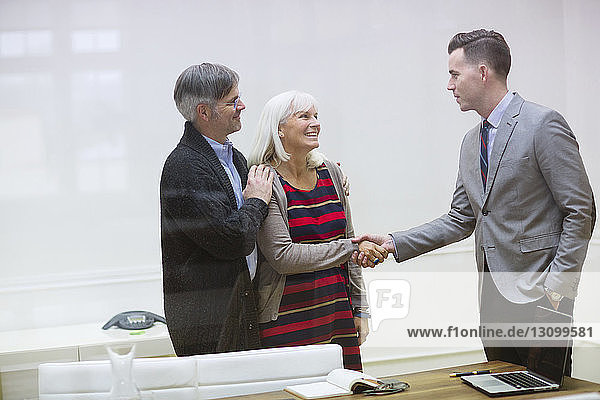 Business people shaking hands in meeting at board room