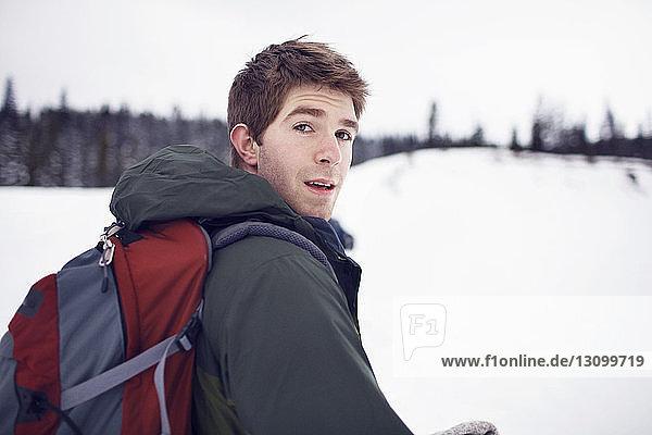 Portrait of backpacker in field