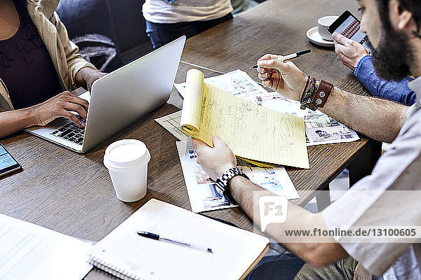 High angle view of business people working at table in office