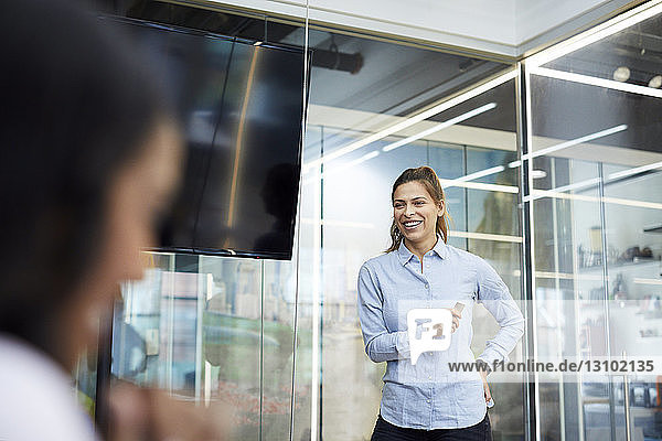 Smiling businesswoman during meeting in office