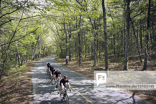 High angle view of cyclists riding bicycles on country road