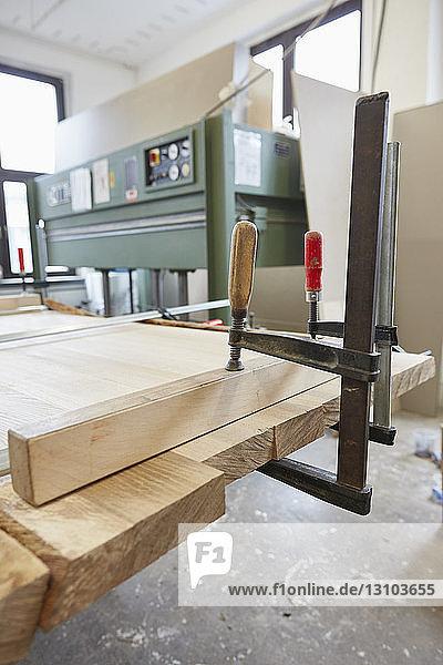 Vise grip clamping wood in carpentry workshop