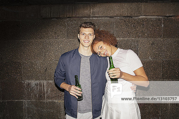 Portrait affectionate young couple drinking beer