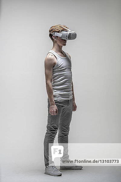 Young man using virtual reality simulator glasses