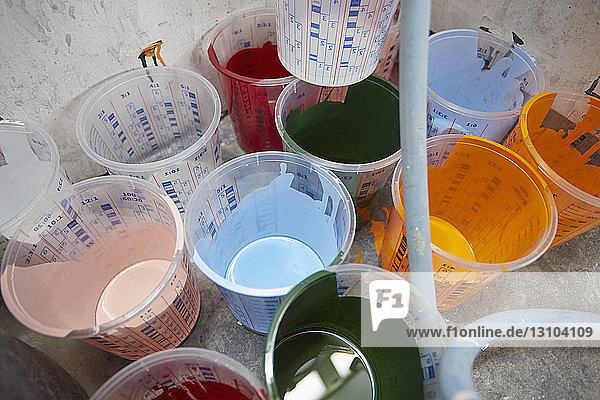 Vibrant  multicolor paint in buckets