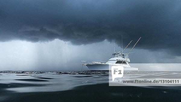 Yacht on ominous stormy ocean Yacht on ominous stormy ocean
