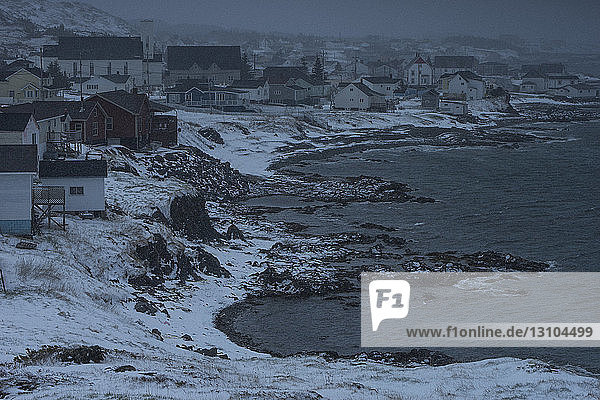 View of town on icy coastline  Twillingate  Newfoundland  Canada View of town on icy coastline, Twillingate, Newfoundland, Canada
