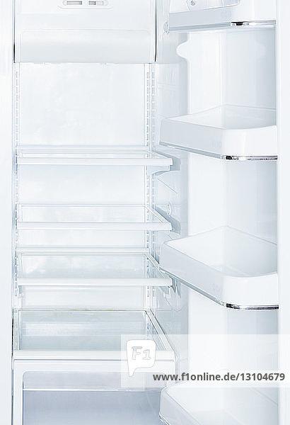Empty  open white refrigerator