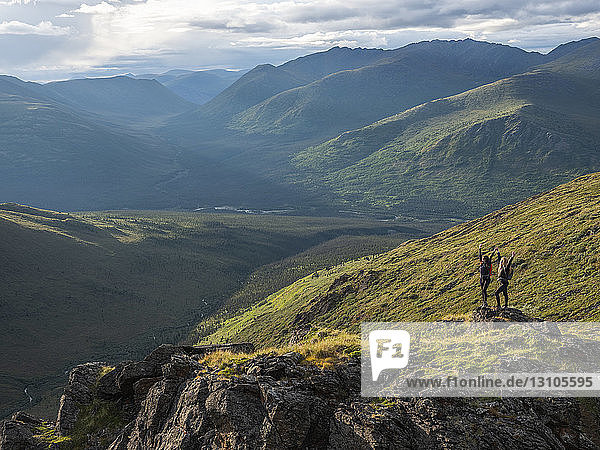 Two women exploring the mountains and wilderness of the Yukon. Feeling alive and vibrant in the beautiful scenery around Haines Junction; Yukon  Canada