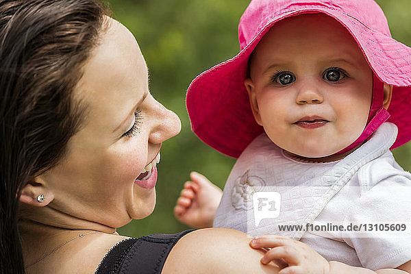 A young mother spending quality time with her daughter in a park during the summer; Edmonton  Alberta  Canada