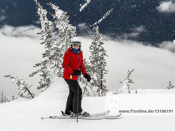 A female downhill skier standing and posing for the camera; Whistler  British Columbia  Canada