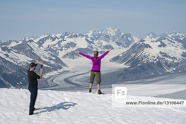 A couple enjoy the sights and scenery of Kluane National Park and Reserve on a bright sunny day; Haines Junction  Yukon  Canada