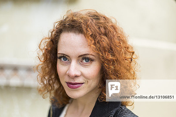 Portrait of a woman with red  curly hair; North Vancouver  British Columbia  Canada