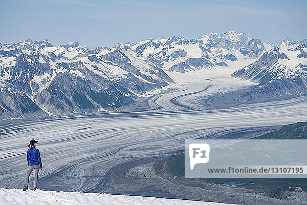 Woman enjoying an afternoon amongst the mountains and glaciers of Kluane National Park and Reserve; Haines Junction  Yukon  Canada