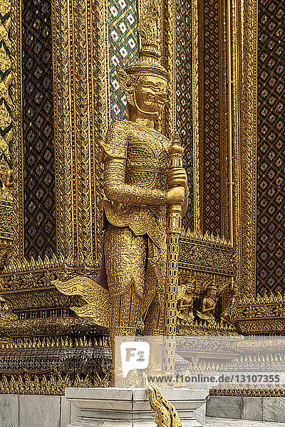 Temple of the Emerald Buddha golden guardian statue  Grand Palace; Bangkok  Thailand