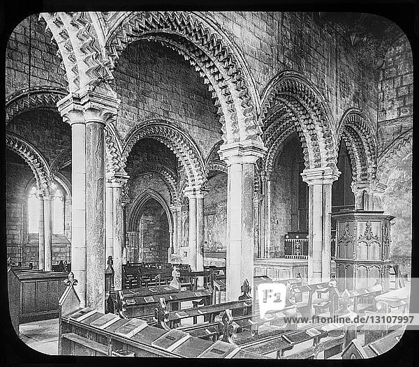 A magic lantern slide circa 1900. Religious slides . Built in the 1170s  it was originally planned as an extension to the eastern end of the Cathedral  which was always full of pilgrims and therefore cramped. However  due to a change in the level of the bedrock from the rest of the Cathedral  the walls kept on cracking during the construction and all attempts to build it at the eastern end of the Church seemed to fail. This was taken as a sign of divine intervention  and it was built in its current location at the western end of the Cathedral instead. The name Galilee was often used to designate the space at the western end of a church  from which processions start their entry into the building  recalling Christ's entry into Jerusalem from Galilee.