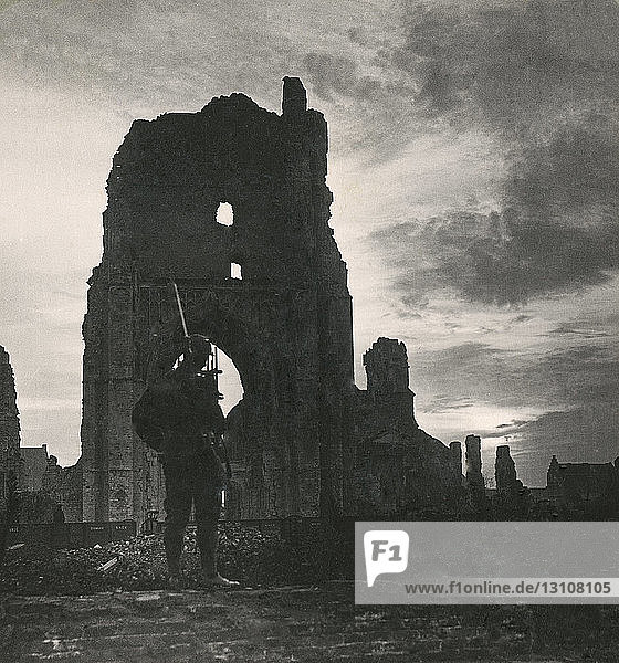 Stereoview  World War One  The Great War  Realistic Travels military photographs circa 1918. Guarding sacred Ypres  where British herosim shone resplendent through the wars darkest hours. Soldier standing in ruined cathedral.