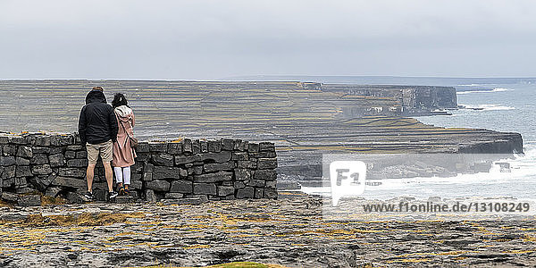 Tourists visit prehistoric fort of Dun Aonghasa  perched on top of a high cliff  Inishmore  Aran Islands; Kilronan  County Galway  Ireland