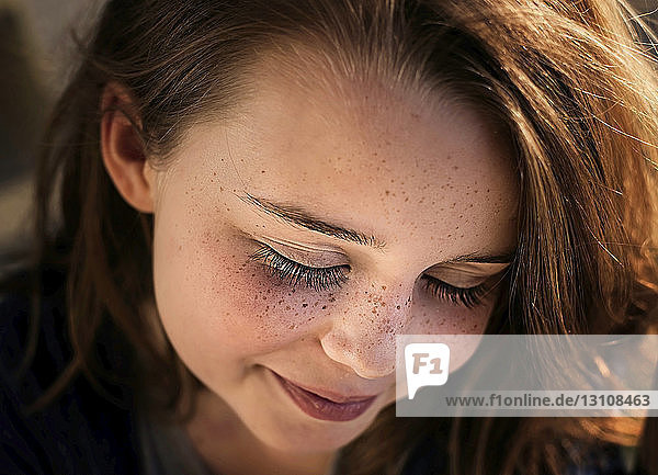 Close-up of happy girl with eyes closed