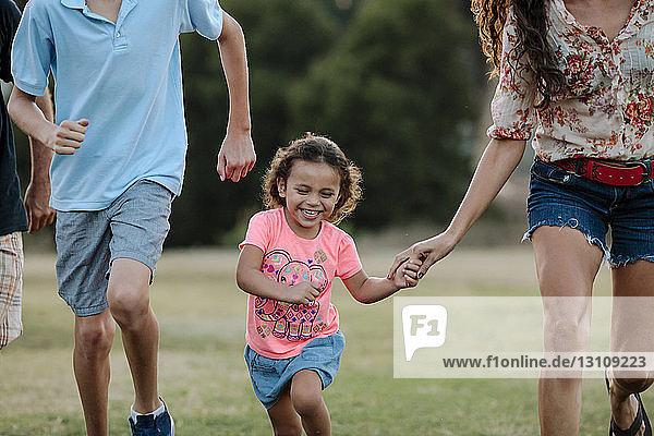 Playful family running at park